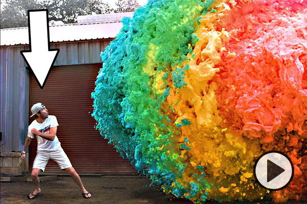 YouTuber Mark Rober is looking at and running from a rainbow colored explosion of goo.
