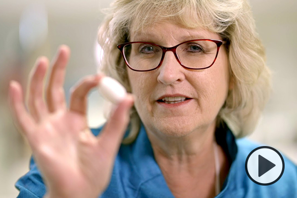 BYU professor Dawna Baugh shows a silkworm cocoon.