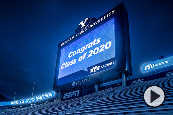 The stadium scoreboard and LED strips at Lavell Edwards Stadium display the messages We're all in this together, Congrats Class of 2020, and BYU Alumni.