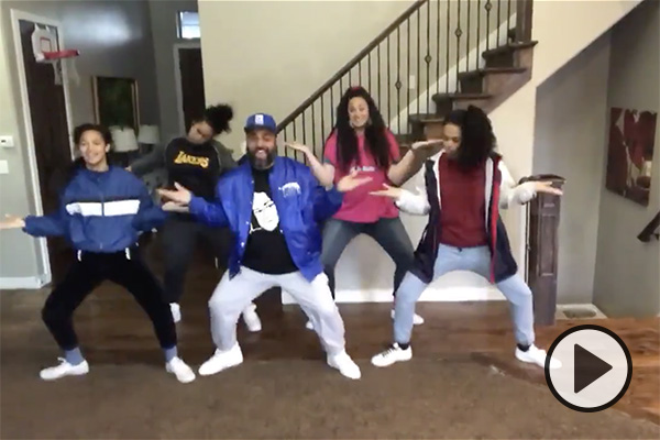 Five members of Reno Mahe's family show off their dance moves.